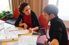 Andrey Butsman, National Programme Officer at the OSCE Centre in Bishkek (l), and Shorena Zakariadze, Specialist at the NATO Integration Division of International Relations and Euro-Atlantic Integration Department, discuss effective political reporting an